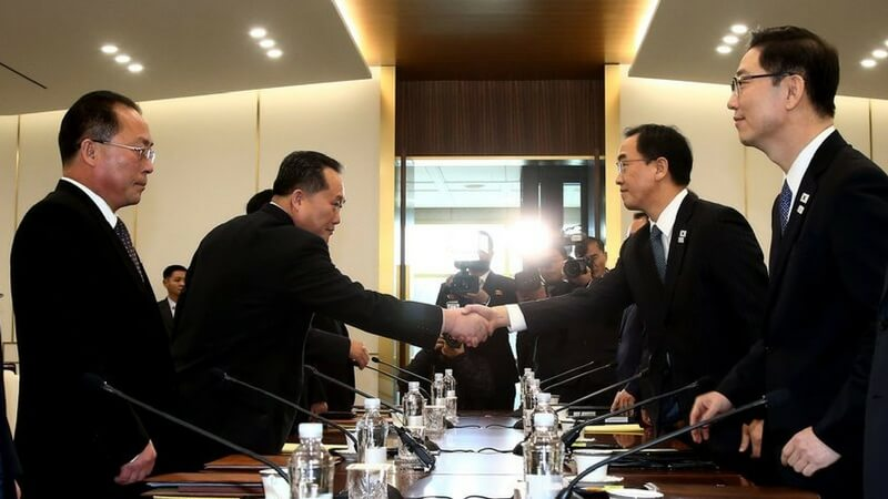 Delegates shaking hands Koreans