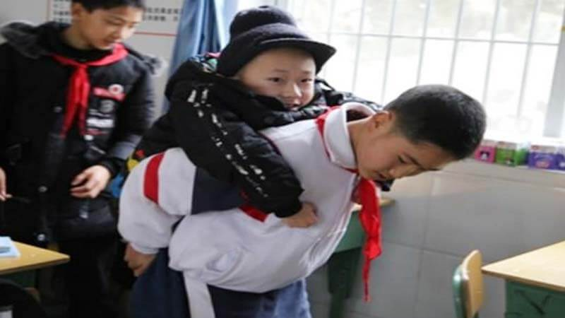 Boy Carries Disabled Friend To School