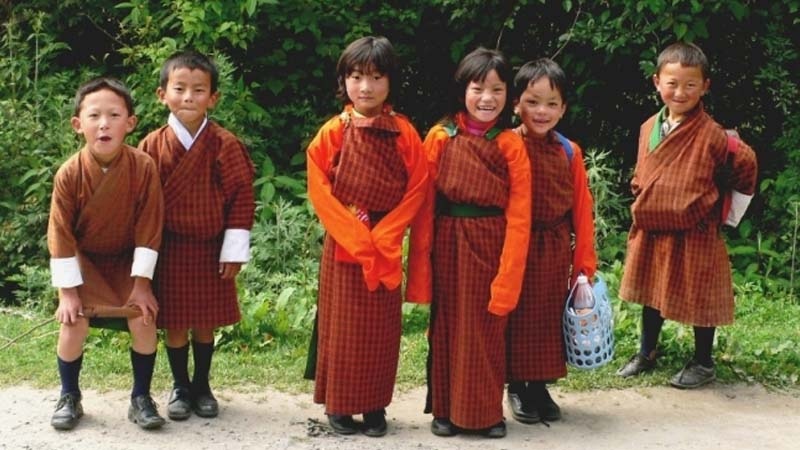 students wear a traditional national costume is Bhutan